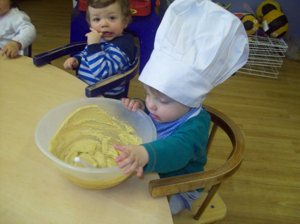 Babies cooking up a tasty treat.  Photo-1