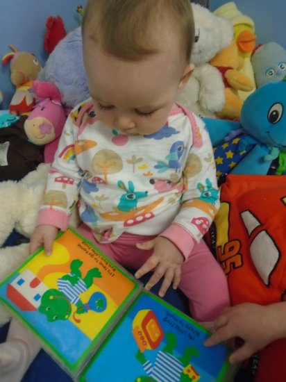 Story time in Busy Bees Baby Room  Photo-1