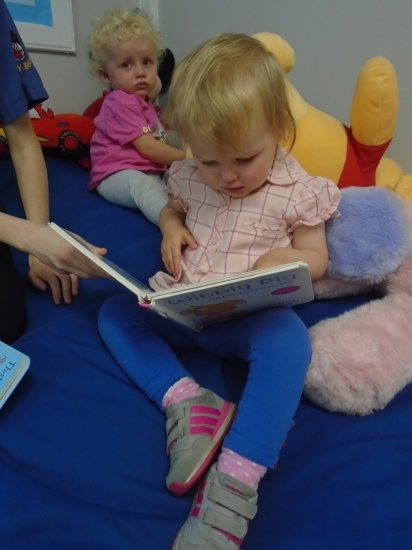 Story time in Busy Bees Baby Room  Photo-3