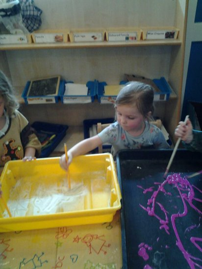 Pre school children making marks to music Photo-1