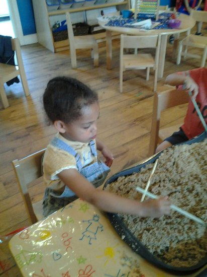 Pre school children making marks to music Photo-2