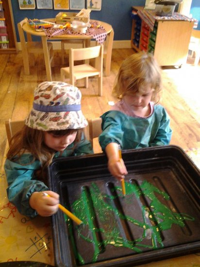 Pre school children making marks to music Photo-4