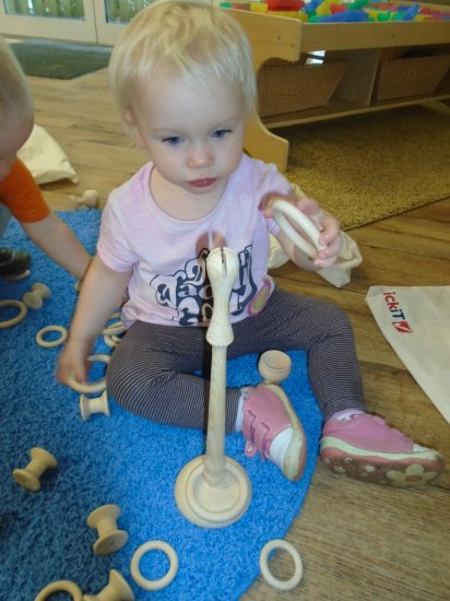 Counting and shape sorting fun in baby room Photo-3
