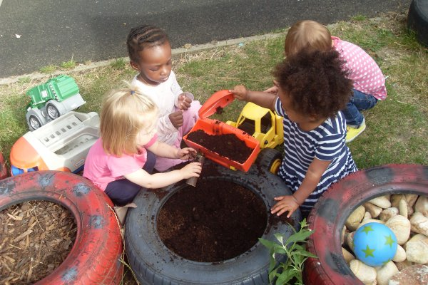 Toddlers exploring the mud garden  Photo-1