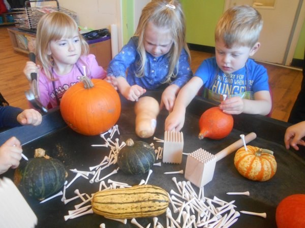 Developing fine motor skills using pumpkins ! Photo-2