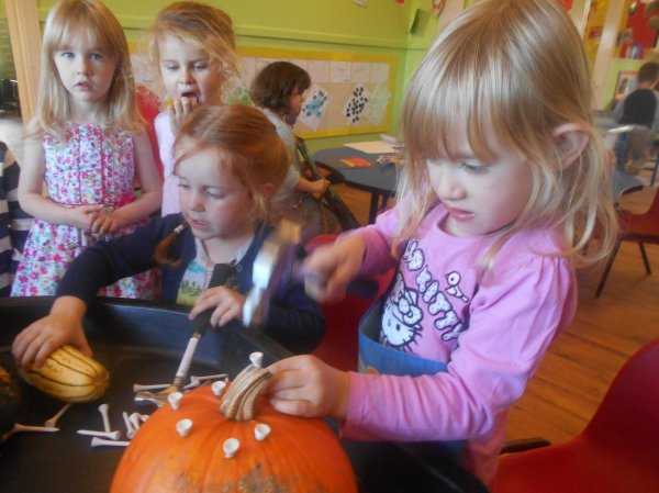 Developing fine motor skills using pumpkins ! Photo-3