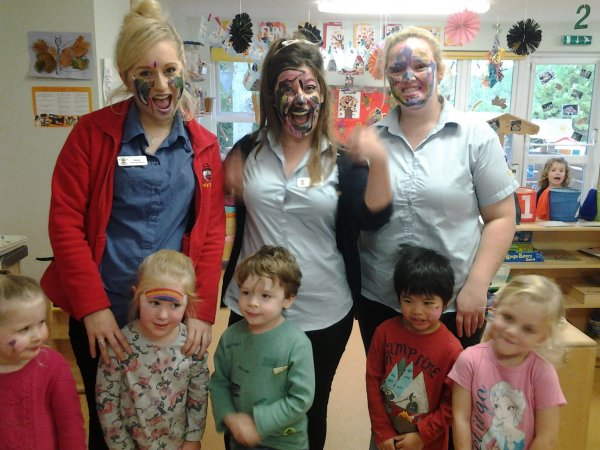 Pre-school children have fun with face painting.  Photo-1