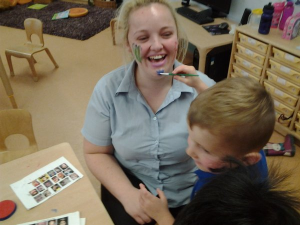 Pre-school children have fun with face painting.  Photo-3