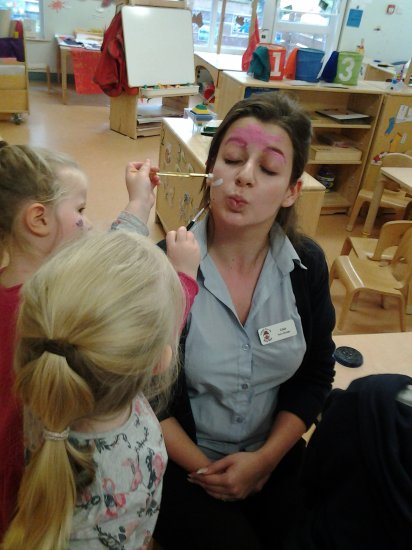 Pre-school children have fun with face painting.  Photo-4