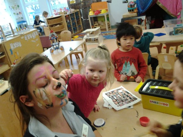 Pre-school children have fun with face painting.  Photo-5