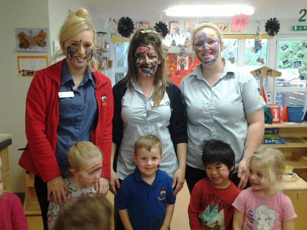 Pre-school children have fun with face painting.  Photo-6
