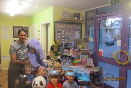Tim West with the Butterfly children and toys we have donated.