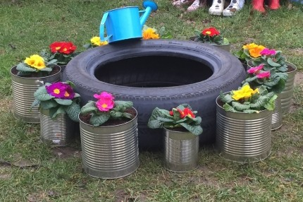 Flower planting in recycled tins