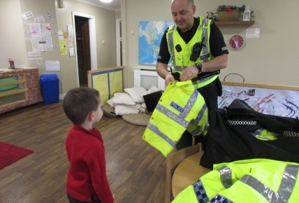 PC Andy Cessford showing the chidlren the bright jackets that he sometimes wears when working