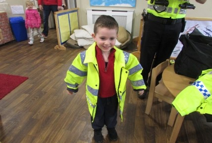 Brodie trying on one of the police jackets!
