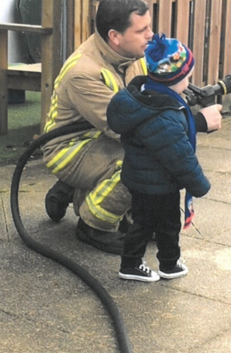 Kian using the fire fighters hose