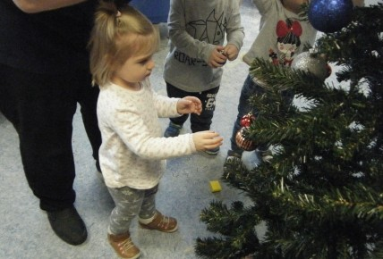 Active Learners Put Up The Christmas Tree Photo-1