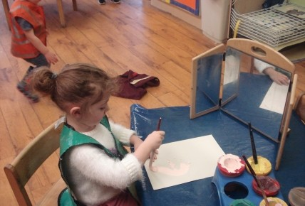 Georgina painting a picture of herself