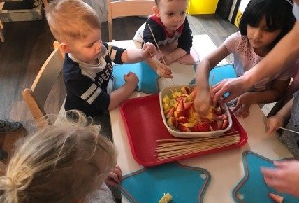 Creating our colourful fruit kebab sticks