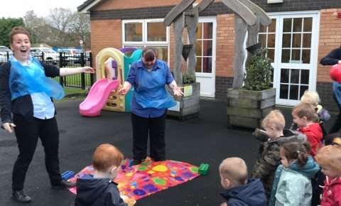 The children and staff loved popping the balloons filled with paint!
