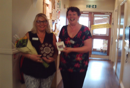 Dawn our Above & Beyond winner receiving her award from Chrissie