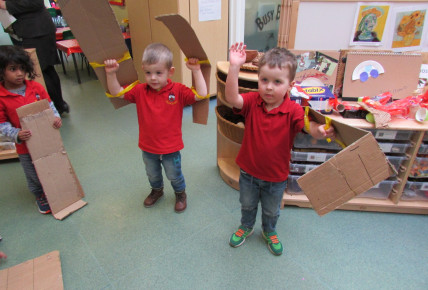 The children made their own cardboard wings so they could be super heroes.