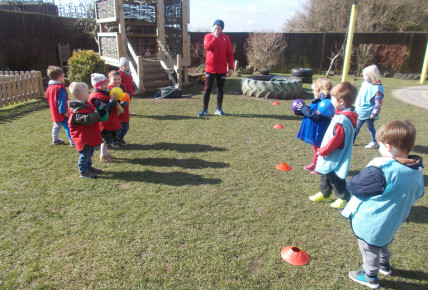 Preschool learning how to play dodgeball in Serious for sport