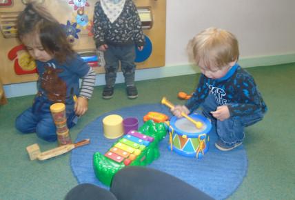 Babies using the musical instruments to create different sounds