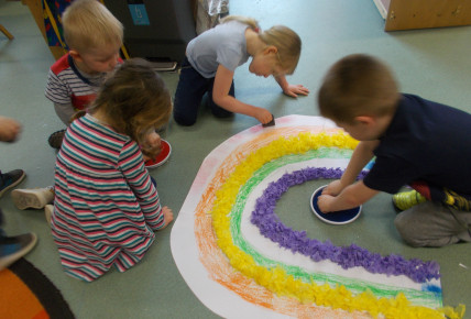 Preschool creating their rainbow using different medias