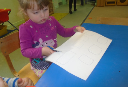 Toddlers practicing their fine motor skills using scissors