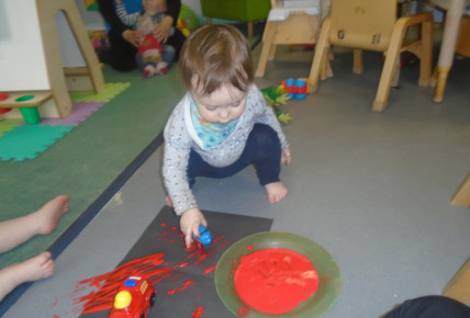 Babies mark making using transport cars