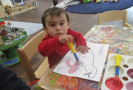 Babies enjoy mixing paints and dinosaurs Photo-1